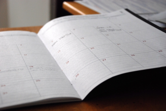 closeup of weekly scheduling planner